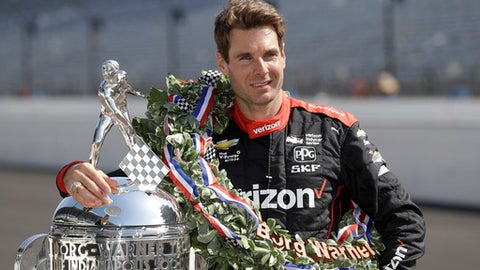 Indianapolis 500 champion Will Power, of Australia, poses with the Borg-Warner Trophy during the traditional winners photo session on the start/finish line at the Indianapolis Motor Speedway, Monday, May 28, 2018, in Indianapolis. (AP Photo/Darron Cummings)
