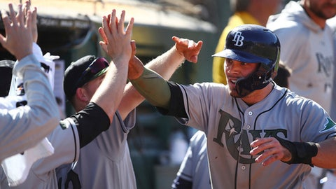 Tampa Bay Rays' Johnny Field, right, celebrates after scoring against the Oakland Athletics in the 13th inning of a baseball game Monday, May 28, 2018, in Oakland, Calif. Field scored on a single by Mallex Smith. (AP Photo/Ben Margot)