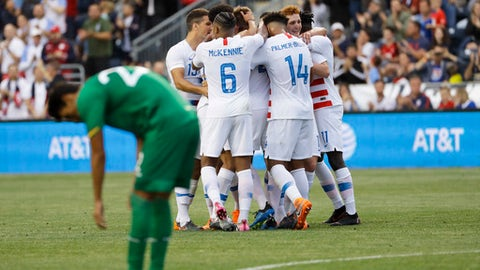 United States players celebrate past Bolivia's Jose Sagredo after a goal by Walker Zimmerman during the first half of an international friendly soccer match, Monday, May 28, 2018, in Chester, Pa. (AP Photo/Matt Slocum)