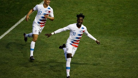 United States' Tim Weah (11) and Antonee Robinson (17) celebrate after Weah's goal during the second half of an international friendly soccer match, Monday, May 28, 2018, in Chester, Pa. The United States won 3-0. (AP Photo/Matt Slocum)