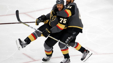 Vegas Golden Knights right wing Ryan Reaves, left, celebrates his goal with left wing Pierre-Edouard Bellemare, of France, during the third period in Game 1 of the NHL hockey Stanley Cup Finals against the Washington Capitals Monday, May 28, 2018, in Las Vegas. (AP Photo/Ross D. Franklin)