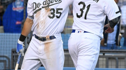 Los Angeles Dodgers' Cody Bellinger, left, congratulates Joc Pederson after he was driven in by Los Angeles Dodgers' Justin Turner during the sixth inning of a baseball game, Monday, May 28, 2018, in Los Angeles. (AP Photo/John McCoy)