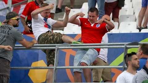 FILE - In this file photo taken on Saturday, June 11, 2016, Clashes break out in the stands during the Euro 2016 Group B soccer match between England and Russia, at the Velodrome stadium in Marseille, France. The violence in Marseille was greeted with jokes and even praise from some Russian lawmakers and officials. But ahead of the World Cup, Russian authorities are cracking down on the hooligan culture. (AP Photo/Thanassis Stavrakis, File)