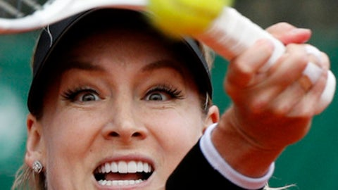 Bethanie Mattek-Sands of the U.S. slams a forehand to Sweden's Johanna Larsson during their first round match of the French Open tennis tournament at the Roland Garros stadium, Tuesday, May 29, 2018 in Paris. (AP Photo/Christophe Ena)