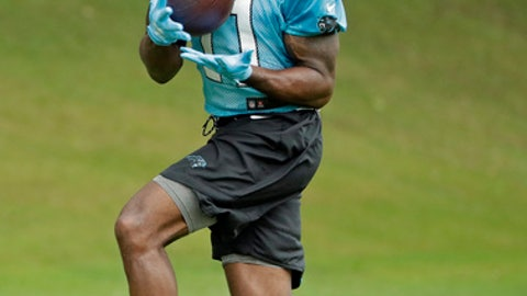 Carolina Panthers' Torrey Smith (11) catches a pass during practice at the NFL football team's facility in Charlotte, N.C., Tuesday, May 29, 2018. (AP Photo/Chuck Burton)