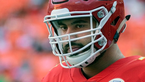 FILE - In this Aug. 11, 2017, file photo, Kansas City Chiefs offensive lineman Laurent Duvernay-Tardif (76) is shown during pre-game warmups before an NFL preseason football game in Kansas City, Mo. Chiefs offensive lineman Laurent Duvernay-Tardif can finally put away the medical books for a while and spend all his free time studying up his playbook. Duvernay-Tardif graduated from McGill University's medical school on Tuesday, May 29, 2018. (AP Photo/Reed Hoffmann, File)