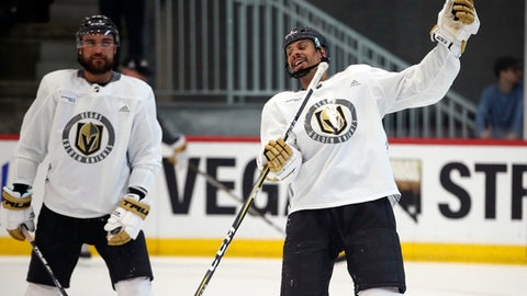 Vegas Golden Knights left wing William Carrier, left, and right wing Ryan Reaves joke around during practice Tuesday, May 29, 2018, in Las Vegas. Game 2 of the Stanley Cup NHL hockey finals between Vegas and the Washington Capitals is scheduled for Wednesday. (AP Photo/John Locher)