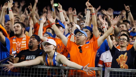 FC Cincinnati fans celebrate after winning their penalty shoot-out during a U.S. Open Cup soccer match against the Chicago Fire, Wednesday, June 28, 2017, in Cincinnati. FC Cincinnati won 3-1 on penalty kicks. (AP Photo/John Minchillo)