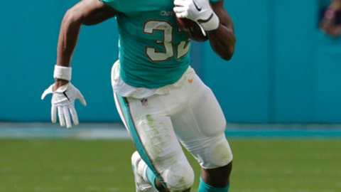 FILE - This Dec. 3, 2017 photo shows Miami Dolphins running back Kenyan Drake (32) running with the ball during the first half of an NFL football game against the Denver Broncos in Miami Gardens, Fla. Third-year pro Kenyan Drake has been with the Miami Dolphins longer than any other running back, which gives him seniority of sorts _ except that his backup is 35-year-old newcomer Frank Gore. Even so, Drake considers his maturity and experience an asset entering his first season as the starter. (AP Photo/Lynne Sladky)