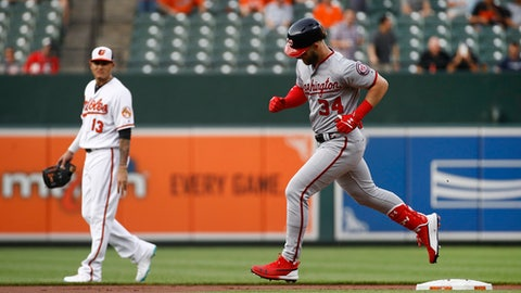 Washington Nationals' Bryce Harper, right, runs the bases past Baltimore Orioles shortstop Manny Machado after hitting a solo home run during the first inning of a baseball game Tuesday, May 29, 2018, in Baltimore. (AP Photo/Patrick Semansky)