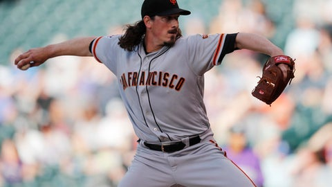 San Francisco Giants starting pitcher Jeff Samardzija winds up during the first inning of the team's baseball game against the Colorado Rockies on Tuesday, May 29, 2018, in Denver. (AP Photo/David Zalubowski)