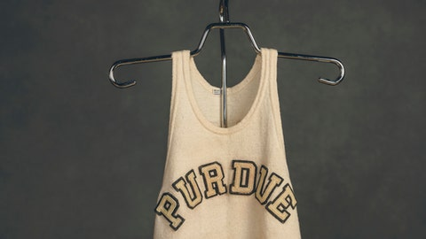 In this photo provided by Purdue University, a 1930s-era Purdue jersey worn by John Wooden is seen in late May 2018 in West Lafayette, Ind. When New Orleans Saints quarterback Drew Brees heard the jersey was being sold at auction, he saw an opportunity to help his alma mater showcase its ties to a man most known for winning 10 NCAA men's basketball titles as UCLA's coach. Brees says he paid $264,000 to win a late-hour bidding war for the jersey in mid-May and will allow Purdue to display it at Mackey Arena in West Lafayette. (Charles Jischke/Purdue University via AP)