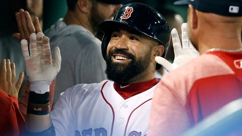 Boston Red Sox's Sandy Leon smiles after his two-run home run during the eighth inning of the team's baseball game against the Toronto Blue Jays, Tuesday, May 29, 2018, in Boston. (AP Photo/Michael Dwyer)