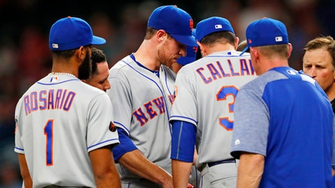 New York Mets starting pitcher Steven Matz, middle talks with manager Mickey Callaway (36) before leaving in the fourth inning of the team's baseball game against the Atlanta Braves on Tuesday, May 29, 2018, in Atlanta. Atlanta won 7-6. (AP Photo/John Bazemore)