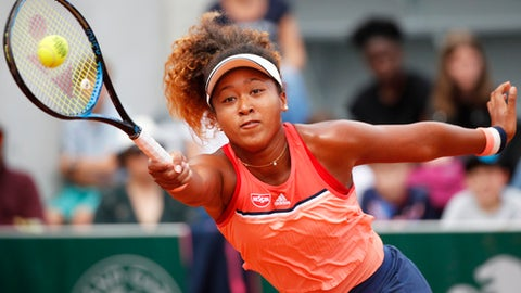 Japan's Naomi Osaka returns a shot against Kazakhstan's Zarina Diyas during their second round match of the French Open tennis tournament at the Roland Garros stadium in Paris, France, Wednesday, May 30, 2018. (AP Photo/Christophe Ena)