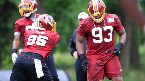 Redskins defensive guard Jonathan Allen (93) is up against Daron Payne (95) during the NFL football team's full practice session at the Redskins Park in Ashburn, Va., Wednesday, May 30, 2018. (AP Photo/Manuel Balce Ceneta)