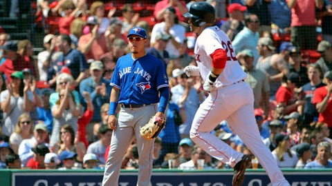 Toronto Blue Jays third baseman Giovanny Urshela watches Boston Red Sox's J.D. Martinez round the bases after his two-run home run in the sixth inning of a baseball game at Fenway Park, Wednesday, May 30, 2018, in Boston. (AP Photo/Elise Amendola)