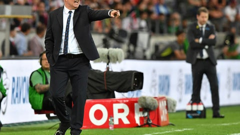 Russia's head coach Stanislav Cherchesov gestures during the friendly soccer match between Austria and Russia in the Tivoli Stadium in Innsbruck, Austria, on Wednesday, May 30, 2018. (AP Photo/Kerstin Joensson)