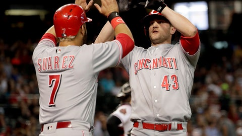 Cincinnati Reds right fielder Scott Schebler (43) high fives Eugenio Suarez (7) after hitting a two run home run against the Arizona Diamondbacks during the sixth inning of a baseball game Wednesday, May 30, 2018, in Phoenix. (AP Photo/Matt York)