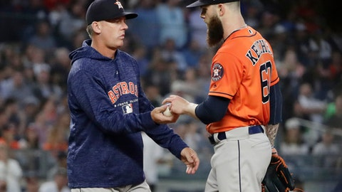 Houston Astros starting pitcher Dallas Keuchel (60) hands the ball to manager AJ Hinch as he leaves during the sixth inning of a baseball game against the New York Yankees on Wednesday, May 30, 2018, in New York. (AP Photo/Frank Franklin II)