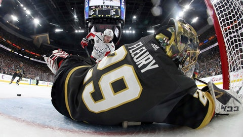 Vegas Golden Knights goaltender Marc-Andre Fleury lies on the ice after stopping a shot by Washington Capitals center Nicklas Backstrom, of Sweden, during the first period in Game 2 of the NHL hockey Stanley Cup Finals on Wednesday, May 30, 2018, in Las Vegas. (Bruce Bennett/Pool via AP)