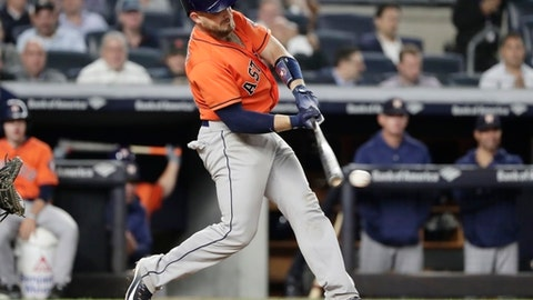 Houston Astros' Max Stassi hits an RBI double during the ninth inning against the New York Yankees in a baseball game Wednesday, May 30, 2018, in New York. The Yankees won 5-3. (AP Photo/Frank Franklin II)