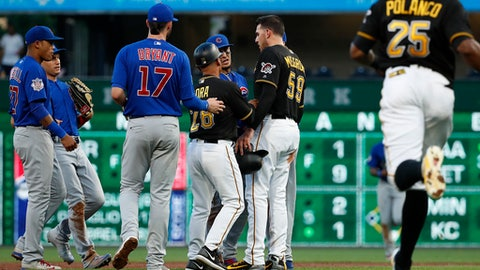 Pittsburgh Pirates third base coach Joey Cora (28) separates Pirates' Joe Musgrove (59) and Chicago Cubs second baseman Javier Baez, rear, as benches clear during the third inning of a baseball game in Pittsburgh, Wednesday, May 30, 2018. Baez took exception to a slide into second by Musgrove, who was out on ball hit by Josh Harrison, who was safe at first on the play. (AP Photo/Gene J. Puskar)