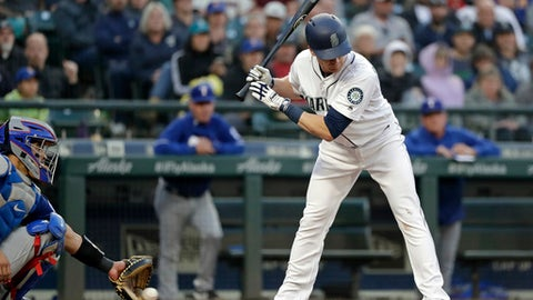 Texas Rangers catcher Robinson Chirinos, left, reaches for but misses a wild pitch as Seattle Mariners' Gordon Beckham looks on in the fourth inning of a baseball game Wednesday, May 30, 2018, in Seattle. Mike Zunino scored. (AP Photo/Elaine Thompson)
