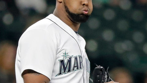 Seattle Mariners relief pitcher Juan Nicasio takes a breath as he heads back to the mound after giving up a pair of runs to the Texas Rangers during the seventh inning of a baseball game Wednesday, May 30, 2018, in Seattle. (AP Photo/Elaine Thompson)