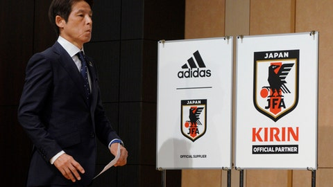 Japanese men's national soccer coach Akira Nishino walks to attend a press conference to announce Japanese squad members for the World Cup Russia in Tokyo, Japan, Thursday, May 31, 2018. (AP Photo/Eugene Hoshiko)