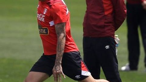 FILE - In this Oct. 1, 2017 file photo, Peru's national soccer team coach Ricardo Gareca, of Argentina, watches Paolo Guerrero strike a ball during a training session in Lima, Peru. Without any previous experience coaching a national team, Gareca led Peru to the World Cup finals for the first time in 36 years. (AP Photo/Martin Mejia, File)
