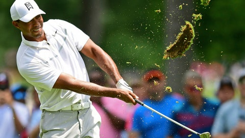 Tiger Woods follows through on his swing on the ninth hole during the first round of the Memorial golf tournament Thursday, May 31, 2018, in Dublin, Ohio. (AP Photo/David Dermer)