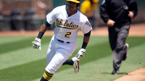 Oakland Athletics designated hitter Khris Davis (2) scores from second during the second inning of a baseball game against the Tampa Bay Rays, Thursday, May 31, 2018, in Oakland, Calif. (AP Photo/D. Ross Cameron)