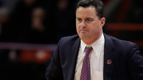 FILE - In this Thursday, March 15, 2018 file photo, Arizona head coach Sean Miller looks on during a first-round game against Buffalo in the NCAA men's college basketball tournament in Boise, Idaho. Arizona went through one of the program's most tumultuous seasons in 2017-18.  The Wildcats were ensnared in an FBI probe in recruiting before the season started, had a key player go down for a long stretch and were linked to the federal probe a second time late in the year. (AP Photo/Ted S. Warren, File)