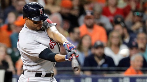 Boston Red Sox's Xander Bogaerts hits a two-run double against the Houston Astros during the third inning of a baseball game Thursday, May 31, 2018, in Houston. (AP Photo/David J. Phillip)