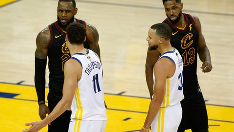 OAKLAND, CA - MAY 31:  LeBron James #23 and Tristan Thompson #13 of the Cleveland Cavaliers exchange words with Klay Thompson #11 and Stephen Curry #30 of the Golden State Warriors in overtime during Game 1 of the 2018 NBA Finals at ORACLE Arena on May 31, 2018 in Oakland, California. (Photo by Lachlan Cunningham/Getty Images)