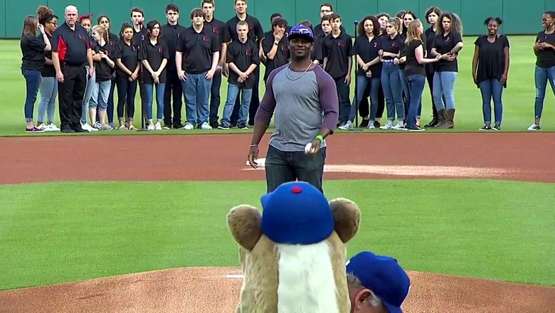 Former TCU running back Ladanian Tomlinson throws out the first pitch