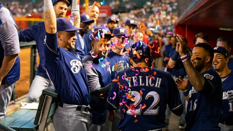 May 16, 2018; Phoenix, AZ, USA; Teammates throw confetti on Milwaukee Brewers outfielder Christian Yelich (22) in the dugout after hitting a two run home run in the second inning against the Arizona Diamondbacks at Chase Field. Mandatory Credit: Mark J. Rebilas-USA TODAY Sports