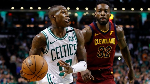 May 13, 2018; Boston, MA, USA; Boston Celtics guard Terry Rozier (12) drives to the basket in front of Cleveland Cavaliers forward Jeff Green (32) during the fourth quarter in game one of the Eastern conference finals of the 2018 NBA Playoffs at TD Garden. Mandatory Credit: David Butler II-USA TODAY Sports