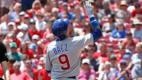 May 20, 2018; Cincinnati, OH, USA; Chicago Cubs shortstop Javier Baez (9) reacts at home after hitting a solo home run against the Cincinnati Reds during the second inning at Great American Ball Park. Mandatory Credit: David Kohl-USA TODAY Sports