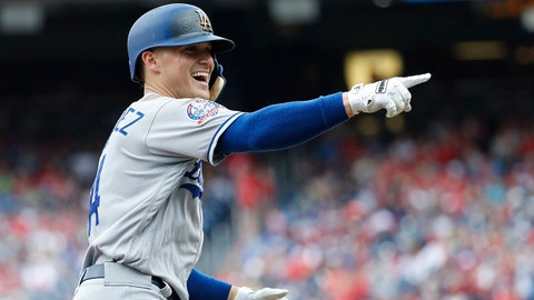 May 20, 2018; Washington, DC, USA; Los Angeles Dodgers center fielder Enrique Hernandez (14) points to the Dodgers' dugout after hitting a two-run home run against the Washington Nationals in the fifth inning at Nationals Park. Mandatory Credit: Geoff Burke-USA TODAY Sports