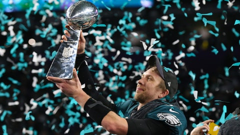 Feb 4, 2018; Minneapolis, MN, USA; Philadelphia Eagles quarterback Nick Foles (9) hoist the Vince Lombardi Trophy after a victory against the New England Patriots in Super Bowl LII at U.S. Bank Stadium. Mandatory Credit: Matthew Emmons-USA TODAY Sports