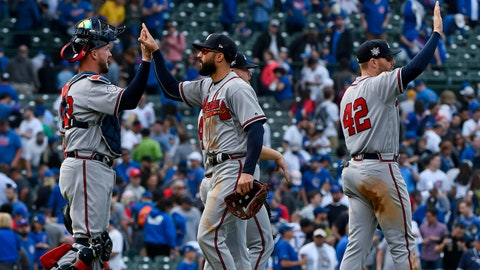 May 14, 2018; Chicago, IL, USA; Atlanta Braves catcher Tyler Flowers , left, and teammates celebrate at the end of their game against the Chicago Cubs at Wrigley Field. The Atlanta Braves won 6-5. Mandatory Credit: Matt Marton-USA TODAY Sports