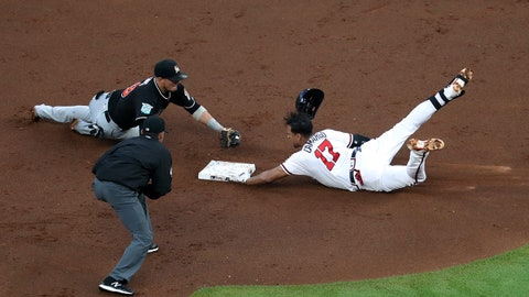 May 18, 2018; Atlanta, GA, USA; Atlanta Braves shortstop Johan Camargo (17) is tagged out at second base by Miami Marlins shortstop Miguel Rojas (19) in the second inning at SunTrust Park. Mandatory Credit: Jason Getz-USA TODAY Sports