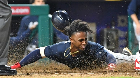 May 22, 2018; Philadelphia, PA, USA; Atlanta Braves second baseman Ozzie Albies (1) slides safely across home plate during the ninth inning against the Philadelphia Phillies at Citizens Bank Park. Mandatory Credit: Eric Hartline-USA TODAY Sports