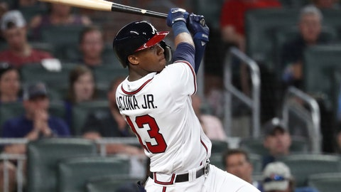 May 15, 2018; Atlanta, GA, USA; Atlanta Braves left fielder Ronald Acuna Jr. (13) hits a solo home run in the eighth inning against the Chicago Cubs at SunTrust Park. Mandatory Credit: Jason Getz-USA TODAY Sports