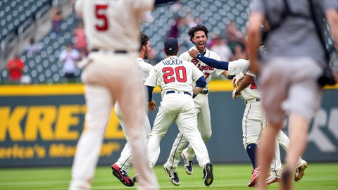 May 20, 2018; Atlanta, GA, USA; Atlanta Braves shortstop Dansby Swanson (7) (facing camera) reacts with team mates after getting the game winning hit against the Miami Marlins during the ninth inning at SunTrust Park. Mandatory Credit: Dale Zanine-USA TODAY Sports