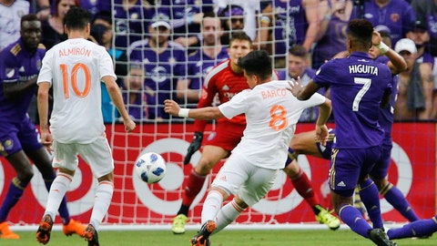 May 13, 2018; Orlando, FL, USA; Atlanta United FC midfielder Ezequiel Barco (8) kicks the ball past Orlando City FC goalkeeper Joseph Bendik (1) for the score  as Orlando's midfielder Cristian Higuita (7) and Atlanta's midfielder Miguel Almiron (10) give chase during the first half at Orlando City Stadium. Mandatory Credit: Reinhold Matay-USA TODAY Sports