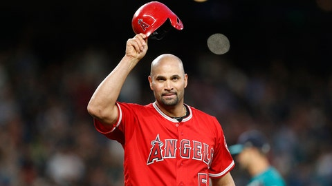 May 4, 2018; Seattle, WA, USA; Los Angeles Angels first baseman Albert Pujols (5) tips his hat to the crowd after recording his 3000th career hit against the Seattle Mariners during the fifth inning at Safeco Field. Mandatory Credit: Jennifer Buchanan-USA TODAY Sports