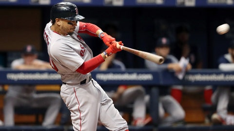 May 22, 2018; St. Petersburg, FL, USA; Boston Red Sox right fielder Mookie Betts (50) hits a 3-run home run during the third inning against the Tampa Bay Rays at Tropicana Field. Mandatory Credit: Kim Klement-USA TODAY Sports